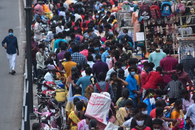 People shop at the crowded Ranganathan street Sunday on World Population Day after the ease in coronavirus lockdown restrictions in Chennai, India. World Population Day is observed every year to raise awareness of global overpopulationissues. India's population is second in the world behind China at 1.4 billion. Photo by Idrees Mohammed/EPA-EFE