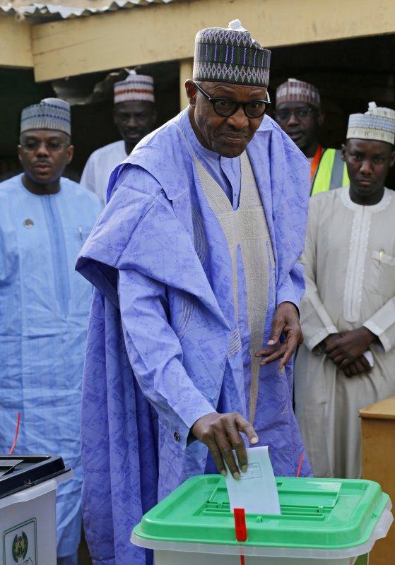Nigerian president Muhammadu Buhari casts his ballot in the presidential elections Saturday. Photo by George Esiri/EPA-EFE