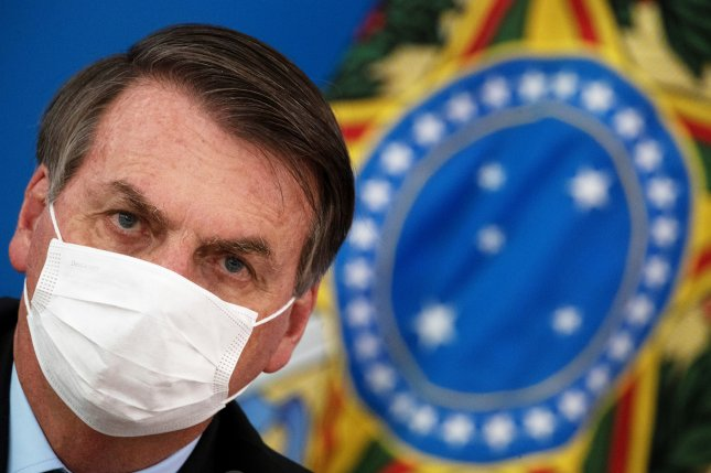 Brazilian President Jair Bolsonaro, seen at a March 18 news conference on government measures to fight the corornavirus pandemic, announced Tuesday he has tested positive for COVID-19. File photo by Joedson Alves/EPA-EFE