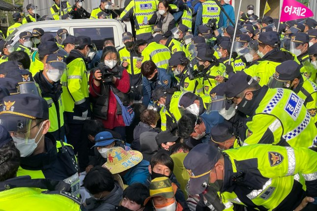 Police break up a sit-in by residents and activists opposing delivery of materials to the U.S. Terminal High Altitude Area Defense base in Seongju, North Gyeongsang Province, South Korea, on Wednesday. Photo by Yonhap/EPA-EFE