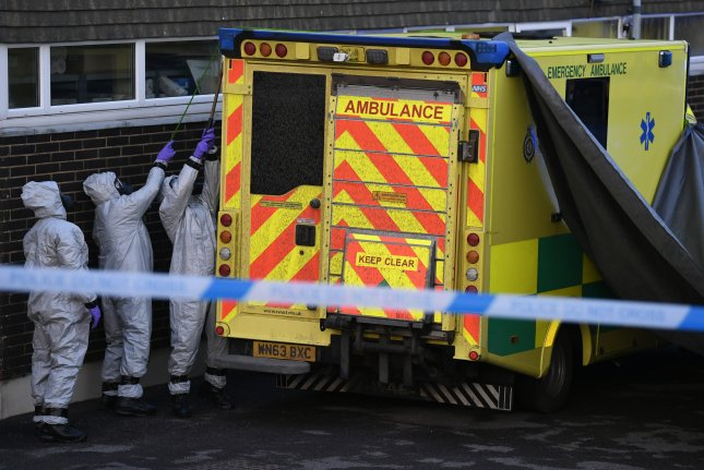 Members of the armed forces in protective suits cover an ambulance at the Salisbury ambulance station in Salisbury, Britain, on Saturday. Russian ex-spy Sergei Skripal and his daughter Yulia, who were attacked with a nerve agent on March 4, 2018, remain in a 'very serious' condition. Photo by Neil Hall/EPA-EFE