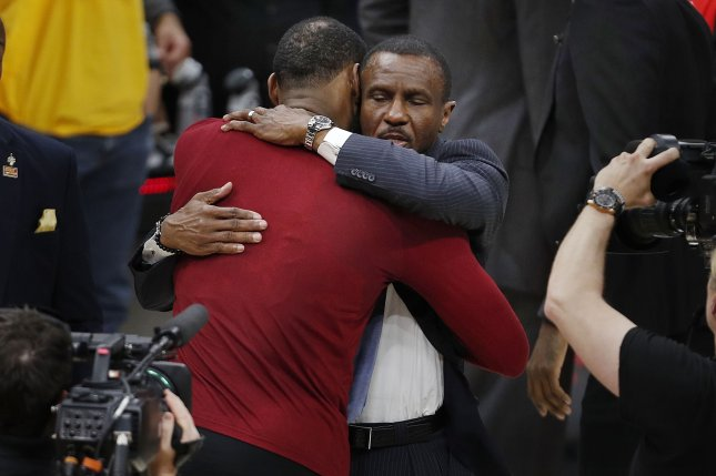 Cleveland Cavaliers forward LeBron James (L) embraces Toronto Raptors head coach Dwane Casey (R) at the end of the NBA Eastern Conference Semifinals basketball Game 4 between Toronto Raptors and the Cleveland Cavaliers on May 7 at Quicken Loans Arena in Cleveland, Ohio. Photo by David Maxwell/EPA-EFE/Shutterstock