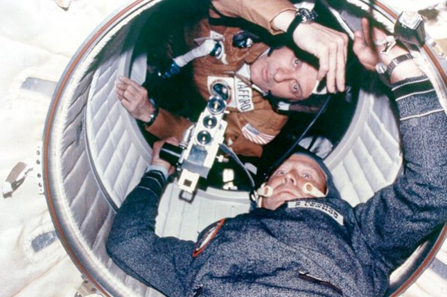 Astronaut Thomas P. Stafford and cosmonaut Aleksei A. Leonov seen at hatchway leading from Apollo Docking Module to Soyuz Orbital Module. Today is the 40th anniversary the Apollo-Soyuz docking, the first American and Russian joint space mission. File photo by NASA