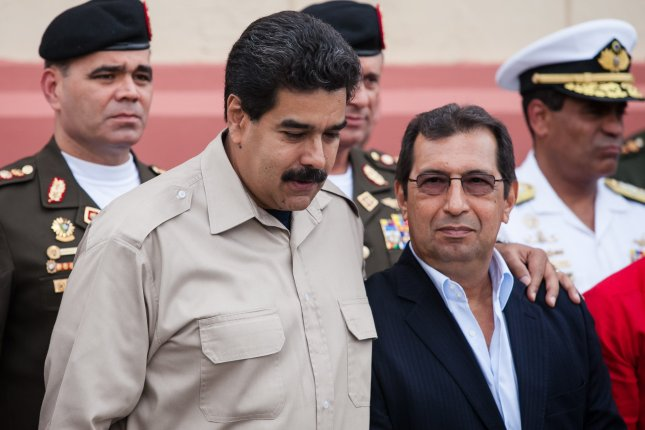 Venezuelan President Nicolas Maduro (L) and brother of late Venezuelan President Hugo Chavez, Adan Chavez (R) visit the place where Chavez's remains are kept in Caracas, Venezuela, on November 5, 2013. On Wednesday, the United States sanctioned several Venezuelan officials accused of supporting the election of a constituent assembly, including Adan Chavez. File Photo by Miguel Gutierrez/EPA