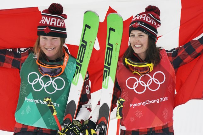Gold medalist Kelsey Serwa (R) of Canada and silver medalist Brittany Phelan of Canada celebrate with the Canadian flag after the Women's Freestyle Skiing Ski Cross competition Friday at the Bokwang Phoenix Park during the Pyeongchang 2018 Olympic Games in South Korea. Photo by Sergei Ilnitsky/EPA-EFE