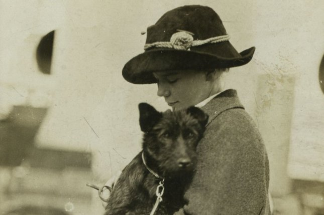 Ethel Roosevelt, daughter of former President Theodore Roosevelt, is pictured holding her dog Bongo during a family trip on board the SS Kaiserin Auguste Victoria in June 1910. Roosevelt cured Bongo of seasickness on this day in 1910. Photo courtesy Theodore Roosevelt Center