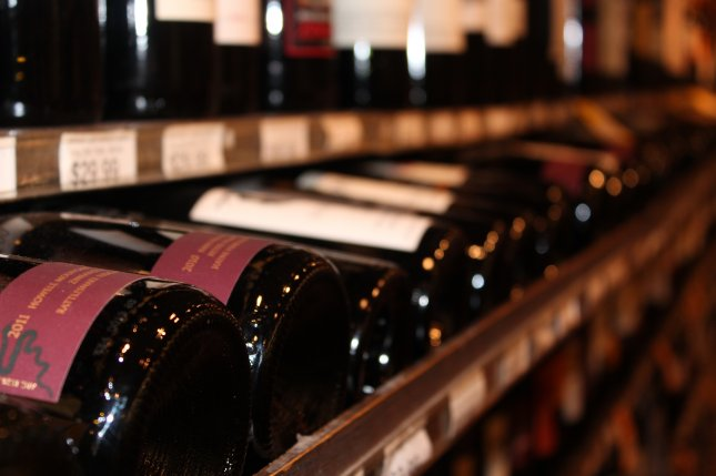 A row of wine bottles at a local liquor store in Washington, DC. (UPI/Billie Jean Shaw)