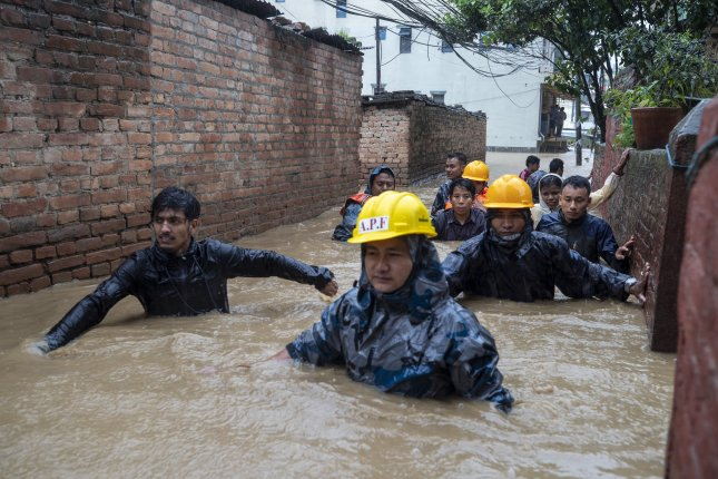 Members of armed police force rescue people from flooded houses following torrential rains in Kathmandu, Nepal. Photo by Narendra Shrestha/EPA-EFE