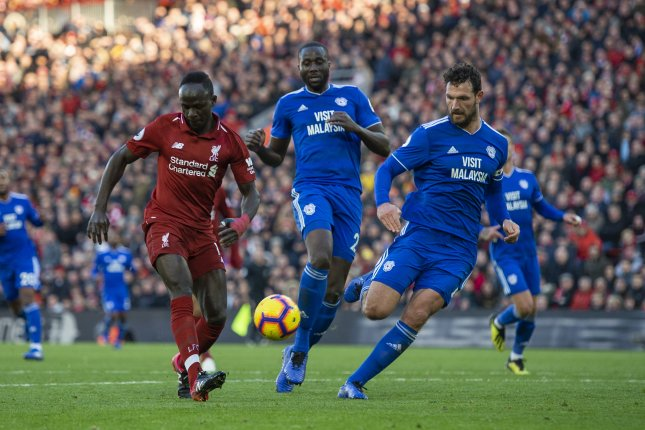 Liverpool forward Sadio Mane (L), who scored in his club's 3-1 win over Arsenal on Monday, has displayed minor symptoms of the virus. File Photo by Peter Powell/EPA-EFE