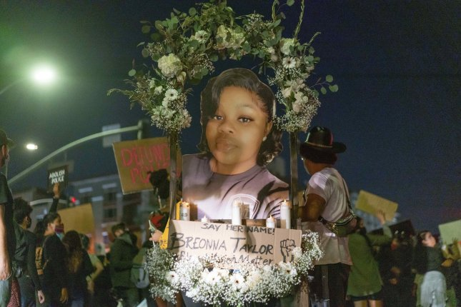 Protesters march with an effigy of Breonna Taylor during a demonstration held to demand justice. File Photo by Kyle Grillot/EPA-EFE