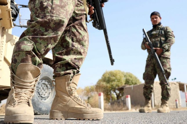 Afghan security officials patrol the districts of Arghandab and Maiwind after the Taliban intensified attacks in Kandahar, Afghanistan, on November 2. File Photo by Muhammad Sadiq/EPA-EFE