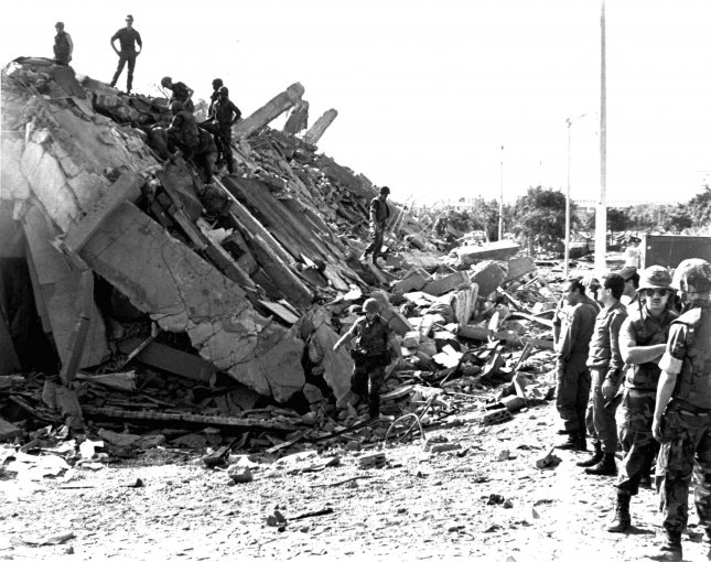 Service members pick through the rubble following the bombing of the USMC barracks in Beirut, Lebanon on Oct. 23, 1983. The terror attack resulted in the deaths of 220 Marines. File Photo by USMC/UPI