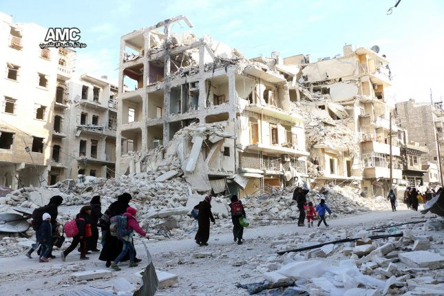 A photo by the Aleppo Media Center shows displaced Syrian families leave the neighborhoods where the fighting occurs in eastern Aleppo, Syria on Nov 29. Syrian government forces said about half of the rebel held portion of the city was now under the Assad regime's control. Photo courtesy Aleppo Media Center/European Press Agency