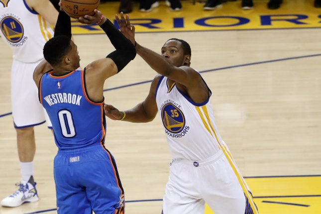 bdf30fb37db Oklahoma City Thunder guard Russell Westbrook (L) shoots as Golden State  Warriors forward Kevin Durant (R) defends. Photo by John G. Mabanglo EPA.