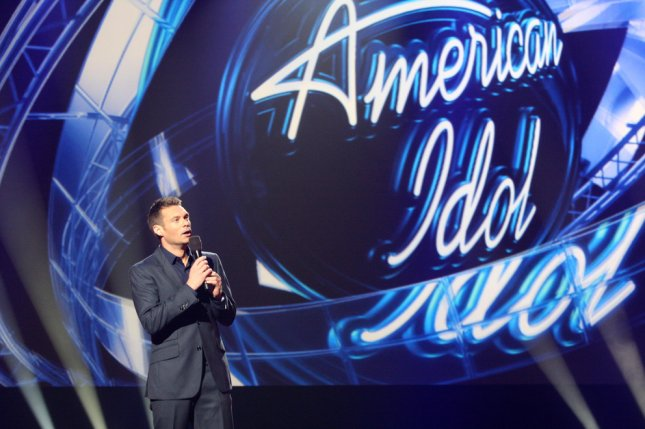 Ryan Seacrest signed its TV audience out for the last time Thursday night as the show ended its 15-year run on FOX with a massive reunion of past contestants and winners including Jennifer Hudson, Jessica Sanchez, Carrie Underwood, Kelly Clarkson, Ruben Studdard and more. File Photo by Helga Esteb/Shutterstock.com