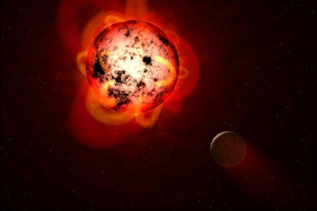 An illustration shows a red dwarf star orbited by a hypothetical exoplanet. Scientists have developed a new way to study the environment around exoplanets, which could make it easier to study their potential habitability. Photo by G. Bacon/STScl/ESA/NASA