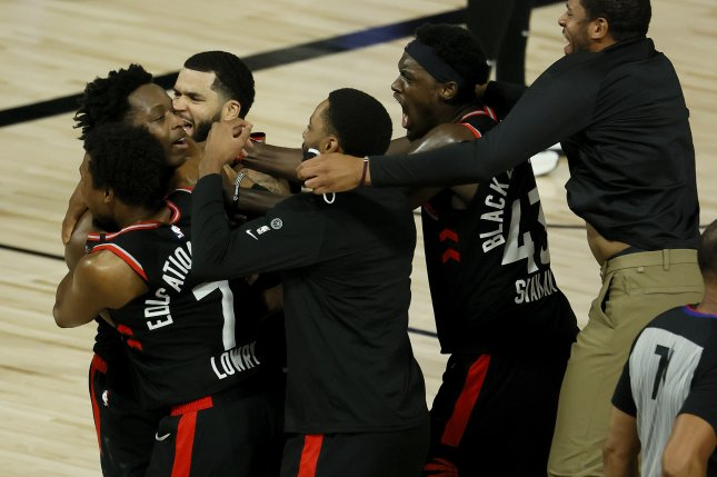 Toronto Raptors forward O.G. Anunoby (L) gets mobbed by teammates after hitting the game-winning shot at the buzzer in Game 3 of their Eastern Conference semifinal series against the Boston Celtics on Thursday at the ESPN Wide World of Sports Complex near Orlando, Fla. Photo by Erik S. Lesser/EPA-EFE