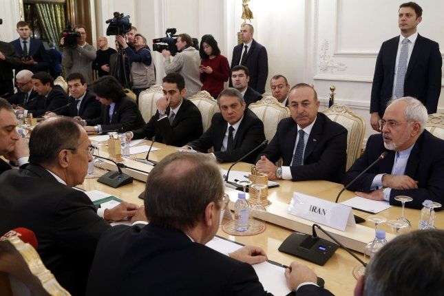 Russian Foreign Minister Sergei Lavrov, second from left, meets with Turkish Foreign Minister Mevlut Cavusoglu, second from right, and Iranian Foreign Minister Mohammad Javad Zarif (R) in Moscow on Tuesday to discuss the Syrian crisis. Photo by Maxim Shipenkov/European Pressphoto Agency