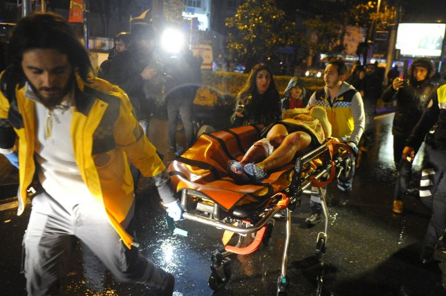 Medics carry a wounded victim to an ambulance after a terror attack on Reina, a popular nightclub in Istanbul, Turkey, on December 31. The Pentagon said Friday one of the plotters of the attack was killed in a U.S. strike on April 6. File Photo by Murat Ergin/EPA