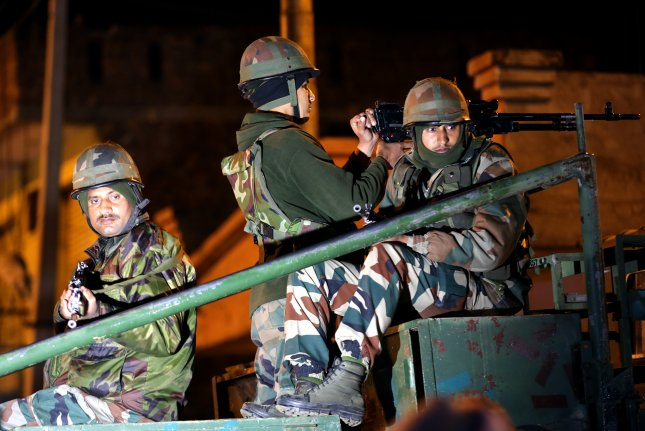 Indian army soldiers on alert outside the Sunjwan military station in Jammu, India, on Saturday, where two soldiers and three terrorists were killed during an attack on the military camp.Photo by Jaipal Singh/EPA-EFE