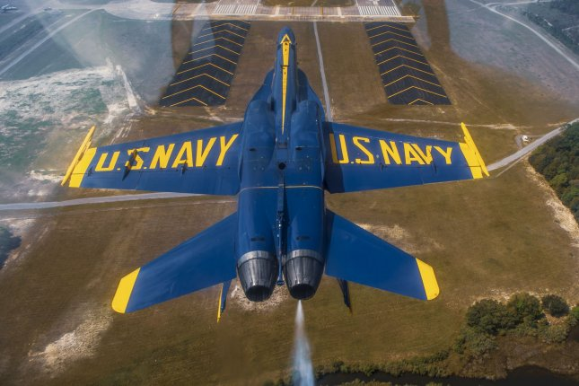 Commander Brian Kesselring, the U.S. Navy Flight Demonstration Squadron, the Blue Angels, commanding officer and flight leader, conducts the Double Farvel maneuver during a training flight over Naval Air StationPensacola. File Photo by Mass Communication Specialist 2nd Class Christopher Gordon/U.S. Navy