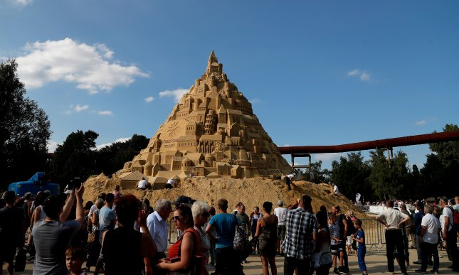 A German travel agency used 3,500 tons of sand to construct the world's tallest sandcastle, measuring 54 feet and 9 inches tall. Photo by Friedmann Vogel/EPA