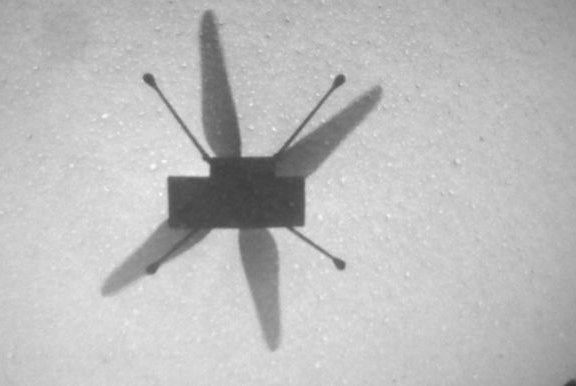 NASA's Mars helicopter Ingenuity captures a photo of its shadow as it flies for the seventh time on the Red Planet. Photo courtesy of NASA
