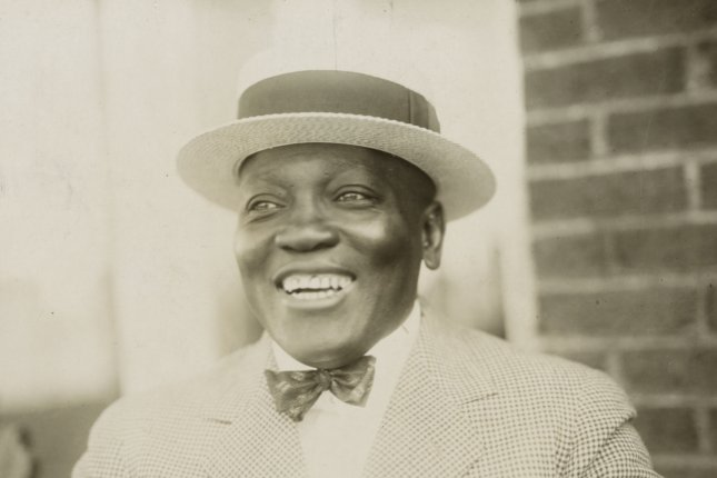 On December 26, 1908, Jack Johnson, with a 14th-round KO of Tommy Burns in Australia, became the first African-American to win the world heavyweight boxing title. File Photo by Library of Congress/UPI