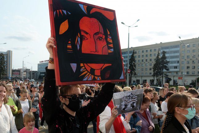 Belarusian women protest Saturday against the presidential election results during a women's march in Minsk. Photo by Stringer/EPA-EFE