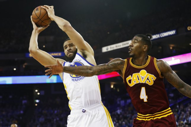 542e31294ce Golden State Warriors center JaVale McGee (L) grabs a rebound away from  Cleveland Cavaliers guard Iman Shumpert (R) during the first half on  January 16