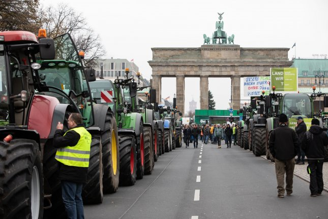 Farmer sin Germany lined up about 5,000 tractors outside the Brandenburg Gate in Berlin on Tuesday in protest of environmental restrictions on the use of fertilizer, pesticide and insecticide. Photo by Omer Messinger/EPA