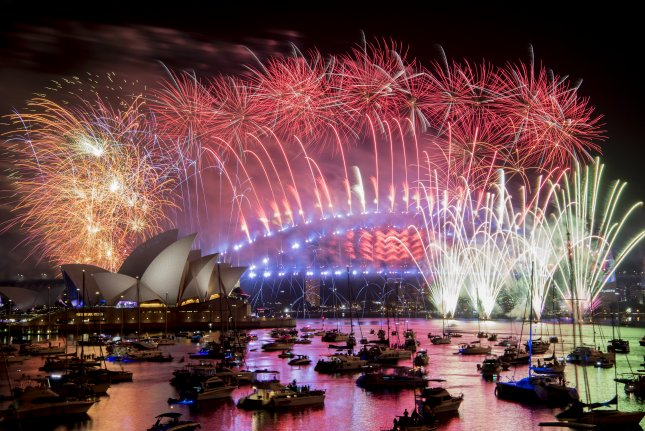 Fireworks explode over the harbor and the Sydney Harbor Bridge after midnight Monday during New Year's celebrations in Sydney, Australia. Photo by Brendan Esposito/EPA-EFE