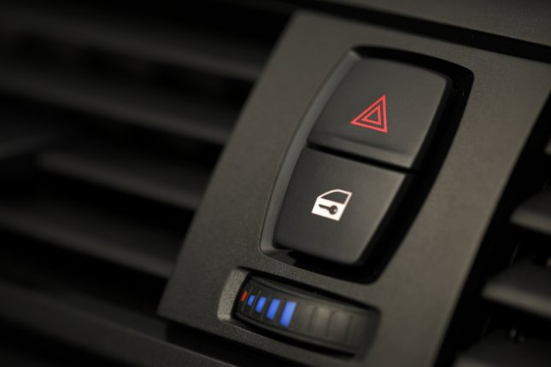 A car's emergency button. Photo by bernie_moto_photo/Shutterstock.com