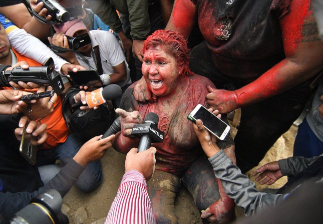 Patricia Arce, the mayor of the Bolivian town of Vinto, was attacked by protesters who forcibly cut her hair and doused her in red paint in response to reports that protestors had been killed. Photo by Jorge Abrego/EPA