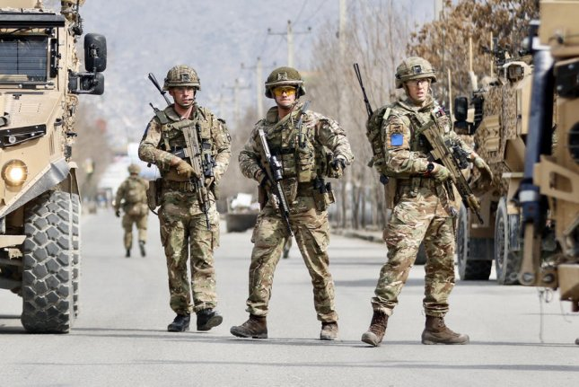 British troops guard the site where gunmen attacked a political gathering in Kabul, Afghanistan, on Friday and killed more than two dozen people. Photo by Hedayatullah Amid/EPA-EFE