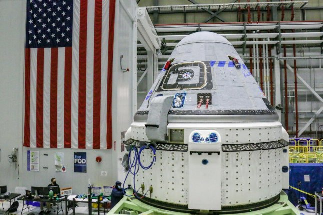 Boeing technicians prepare the Starliner space capsule at Kennedy Space Center for a second test flight planned for July 30. Photo courtesy of Boeing