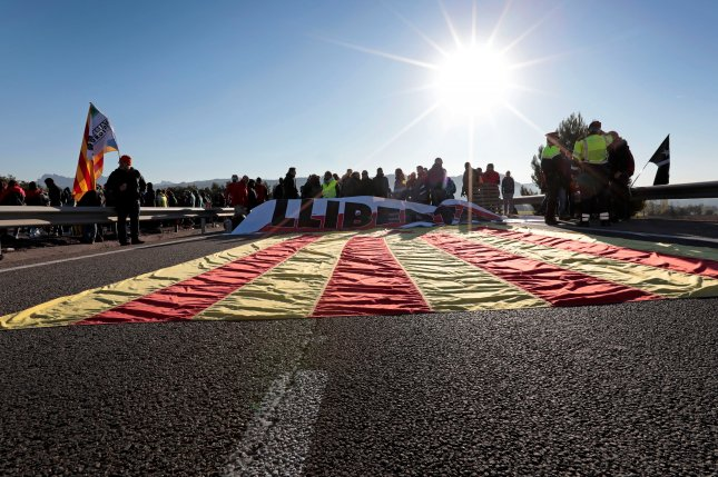 A Catalan flag is seen blocking a road during a strike in Odena, Barcelona, Spain, on Wednesday. Photo by Susana Saez/EPA