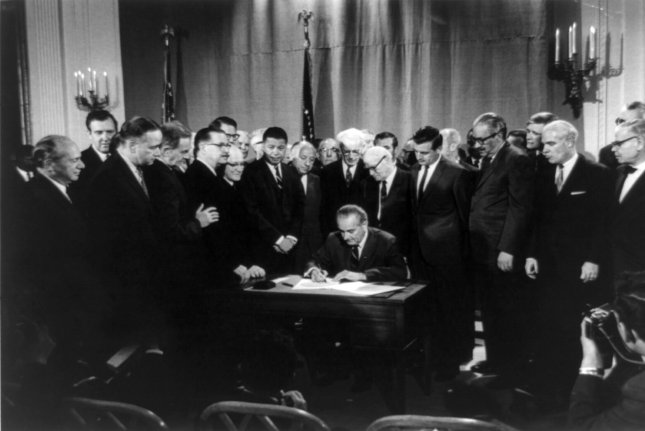 President Lyndon B. Johnson signs an expansion of the Civil Rights Act on April 11, 1968 -- four years after its predecessor was enacted. File Photo courtesy Library of Congress/UPI