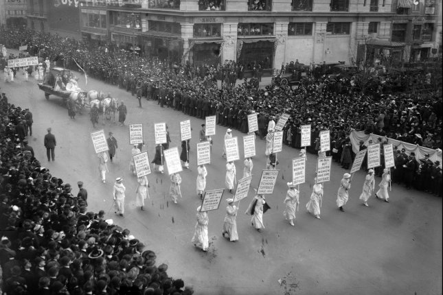 More than 25,000 women take to New York City's Fifth Avenue on October 23, 1915, advocating for women's voting rights. On August 26, 1920, eight days after it was ratified, the 19th Amendment to the U.S. Constitution went into effect -- giving women the right to vote. File Photo by Library of Congress/UPI