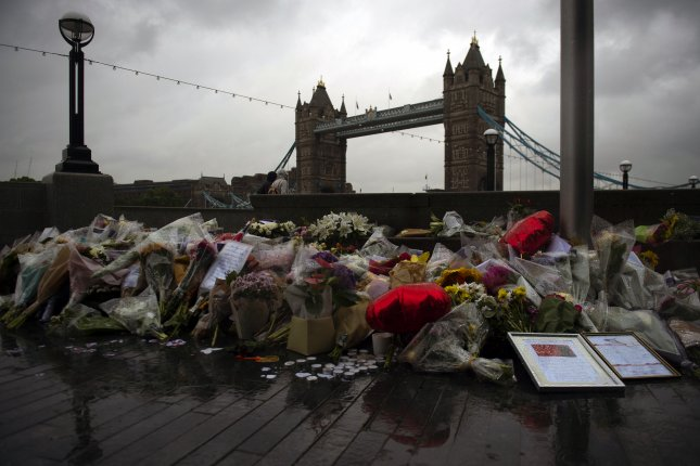 Flowers and tributes were left outside City Hall near Tower Bridge for victims of Saturday's London Bridge attacks in central London on Tuesday. The death toll increased to eight after a victim's body was recovered from River Thames on Tuesday. Photo by Will Oliver/EPA