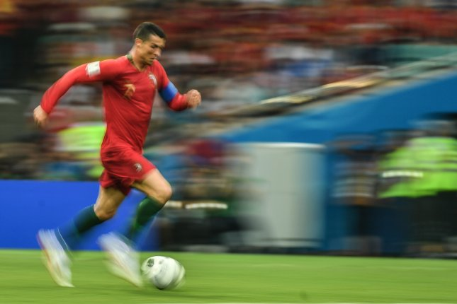 Ronaldo's hat-trick helps Portugal to draw World Cup group