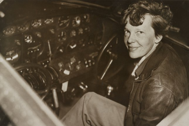 Aviator Amelia Earhart sits in the cockpit of her Electra airplane. On this day in 1937, her plane went down in the Pacific Ocean as she attempted to fly around the world. UPI File Photo