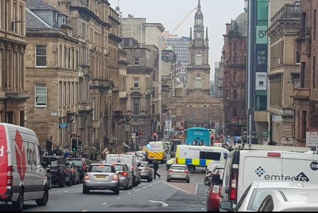 A picture posted on Twitter shows police and emergency responders near the scene of a stabbing incident in downtown Glasgow on Friday. Photo by Patrick Pieciun/EPA-EFE