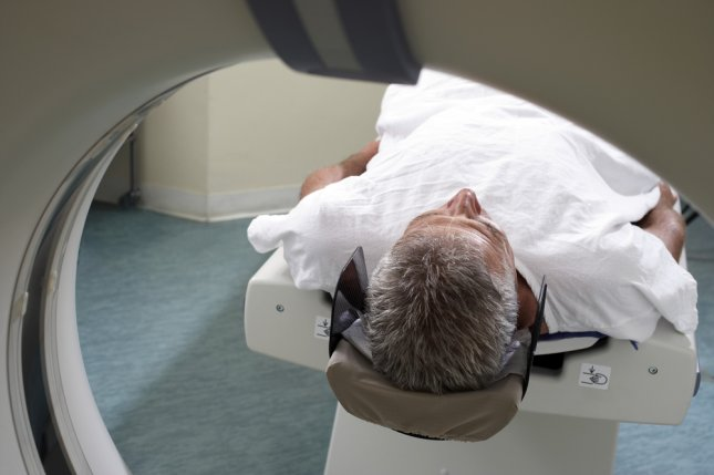 A patient gets an MRI. Photo by Volt Collection/Shutterstock