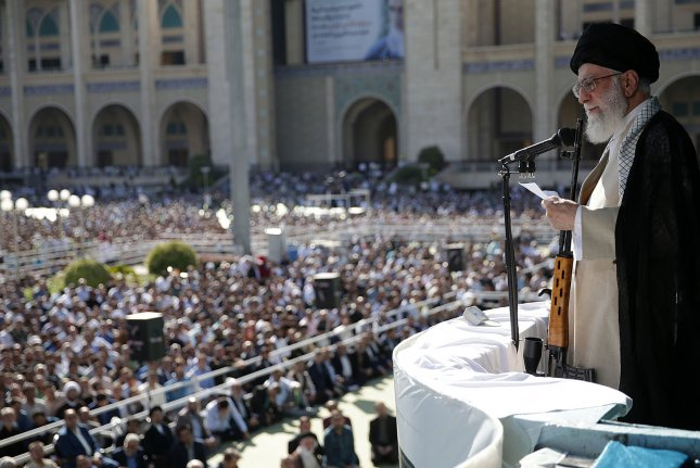 Iranian leader Ali Khamenei speaks to a crowd after the Eid al-Fitr prayers, in Tehran on June 5. File Photo courtesy of Iranian supreme leader's office/EPA-EFE