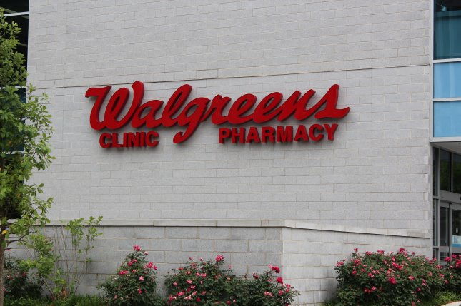 Image of the Walgreens logo at a location in Washington, D.C. Walgreens Boots Alliance said Wednesday it is selling its Alliance Healthcare business to AmerisourceBergen. Photo by Billie Jean Shaw/UPI