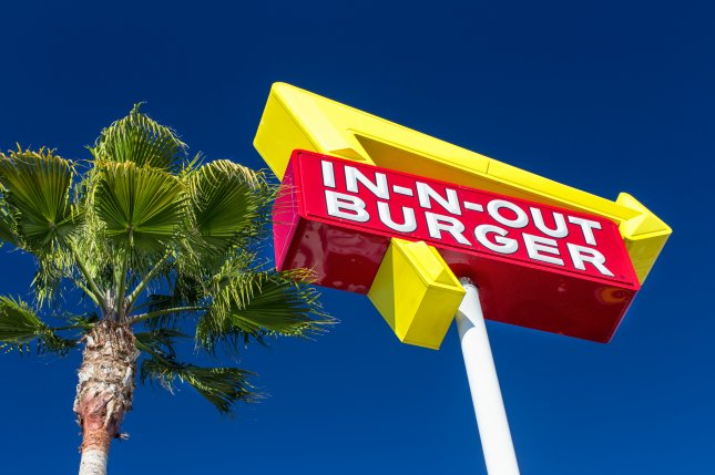 Exterior Sign of an In-N-Out Burger restaurant in Sunnyvale, Calf. A lawsuit filed in Los Angeles alleges a man found two meth capsules at the bottom of the beverage he purchased from an In-N-Out Burger location in Downey, Calf. Photo by Ken Wolter/Shutterstock.com