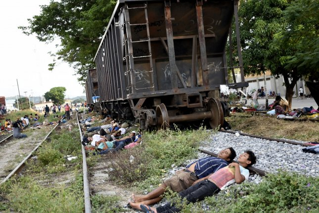 Central American migrants rest in the municipality of Arriaga, state of Chiapas, Mexico, on Friday. Photo by Jacob Garcia/EPA-EFE
