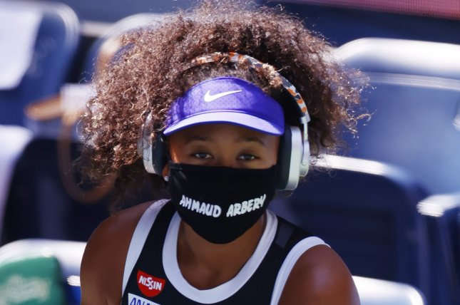 Naomi Osaka wore an Ahmaud Arbery mask before and after her win over Marta Kostyuk on Sept. 4 at the 2020 U.S. Open in Queens, N.Y. Photo by Jason Szenes/EPA-EFE