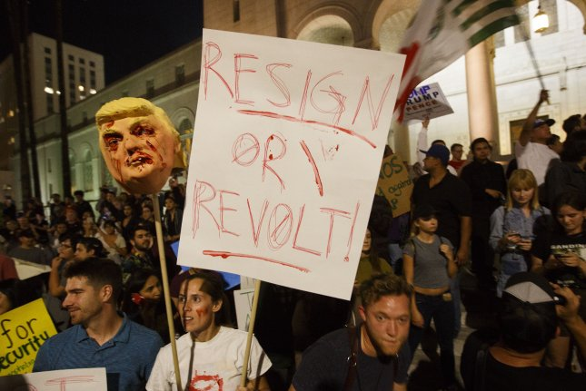 Demonstrators gather during a protest against President-elect Donald Trump outside the City Hall building in Los Angeles on Wednesday. Thousands filled the streets of downtown area of Los Angeles to march against the Trump presidency. Photo by Eugene Garcia/European Press Agency